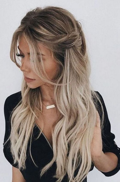 Messy Wavy Hairstyle with Loose Bangs and Lateral Braids