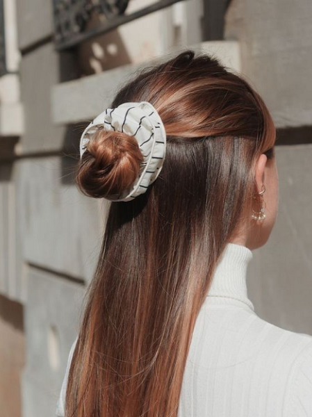 Sleek and Glossy Half Up Half Down Hairstyle with Scunchie and Bun