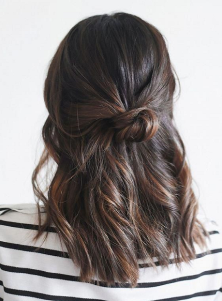 Slightly Wavy Half Up Half Down Hairstyle with Small Messy Knot