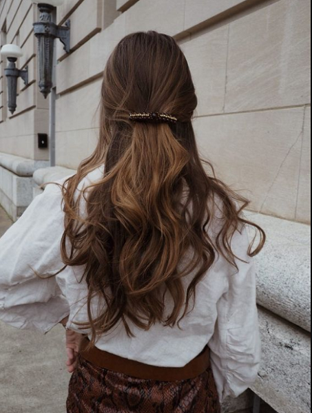 Wavy Half Up Half Down Hairstyle with Elegant Hair Clip