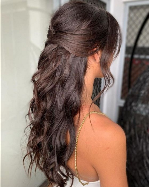 Wavy Half Up Half Down Hairstyle with Loose Bangs