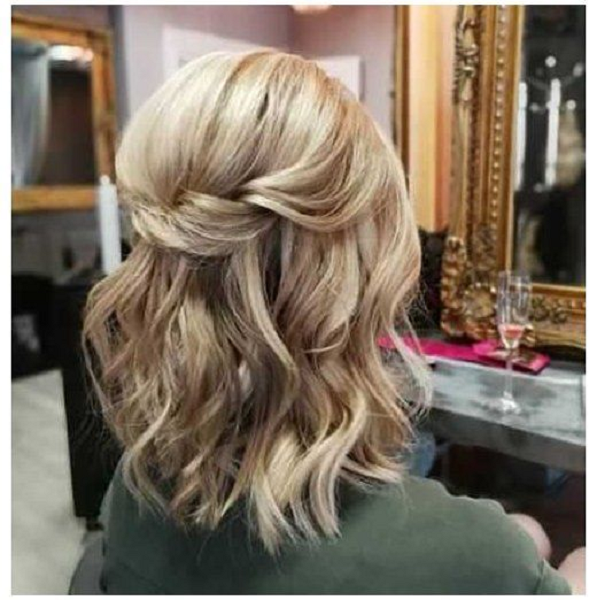 Wavy Half Up Half Down Hairstyle with Loosely Twisted Crown
