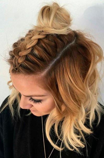 Wavy Half Up Half Down Hairstyle with Messy Bun and Braided Top Area