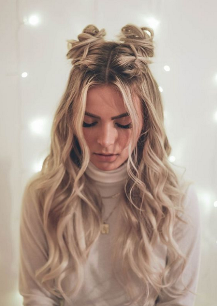 Wavy Half Up Half Down Hairstyle with Space Buns and Middle-Parted Bangs