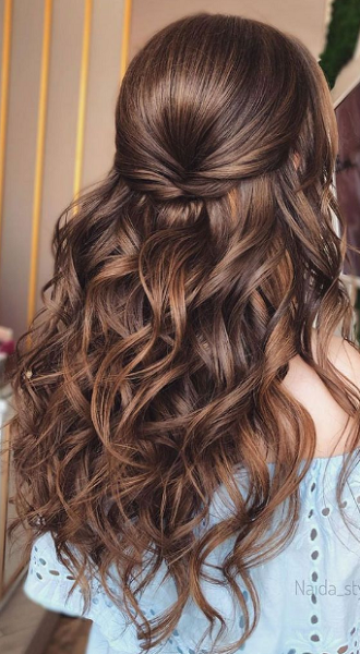 Wavy Half Up Half Down Hairstyle with Twisted Strands