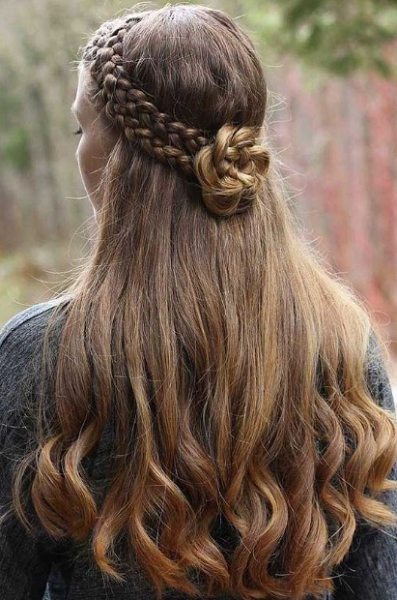 Wavy Half Up Half Hairstyle with Thick Braid Crown and Flower-Like Bun