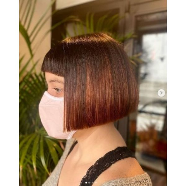 Brown Copper Bob With Straight Bangs And Red Highlights