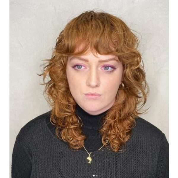 Curly Warm Blonde Shag With Curtain Bangs