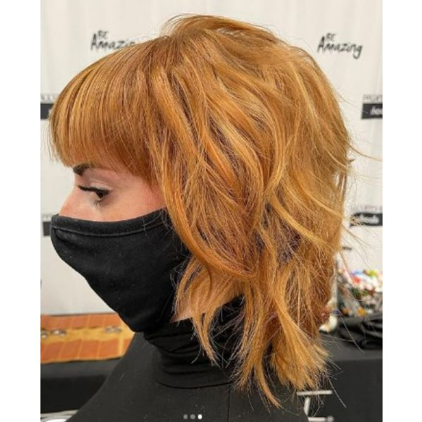 Medium Long Copper Shag Haircut With Straight Bangs