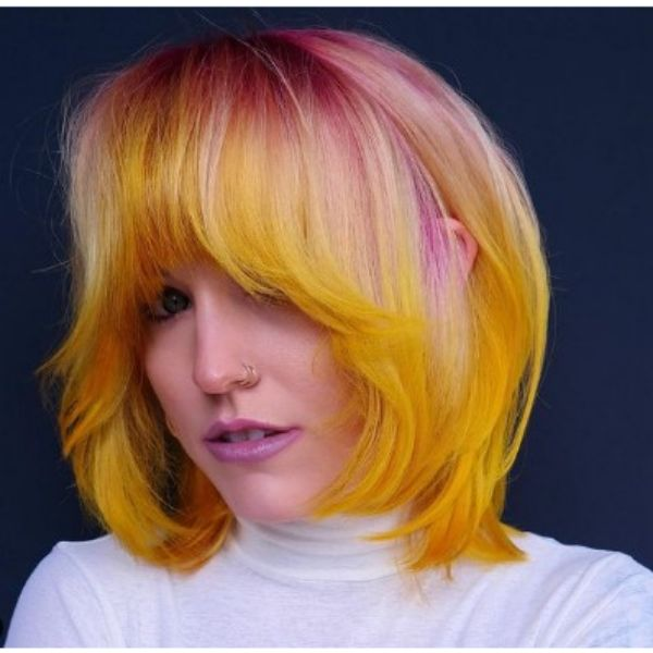 Pastel Colored Shag Haircut With Blonde Tips