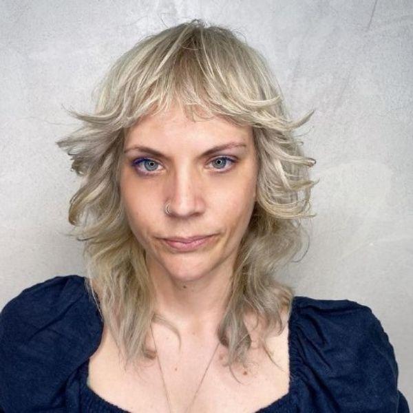 Platinum Blonde Medium Shag Haircut With Wispy Bangs