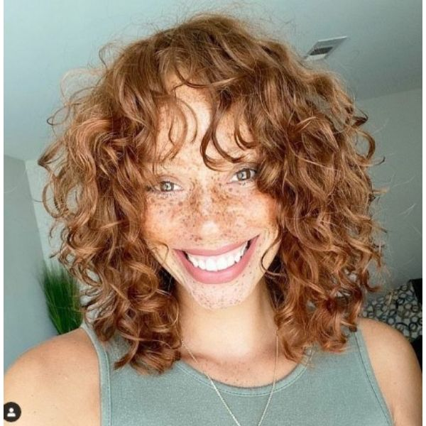 Copper Blonde Curly Shag With Long Bangs