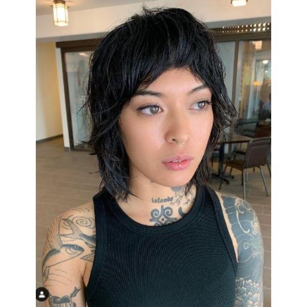 Dark Brunette Shag Haircut With Wispy Strands