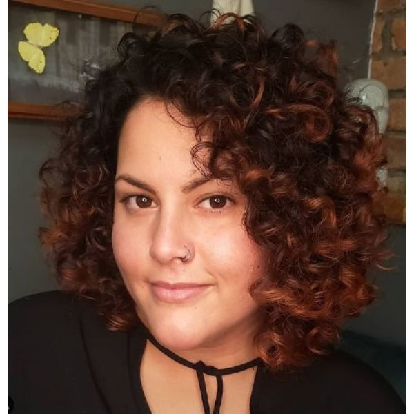 Full Bouncy Shoulder Length Curly Hair With Subtle Red Highlights