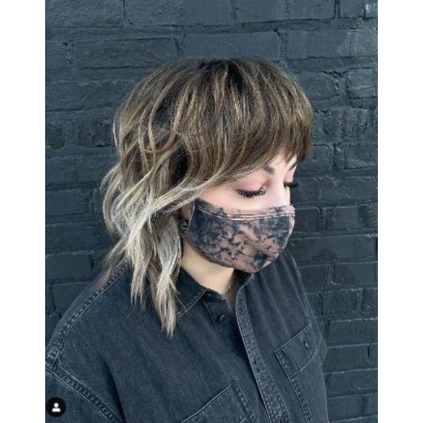 Medium Shaggy Haircut With Curtain Bangs For Balayage Hair