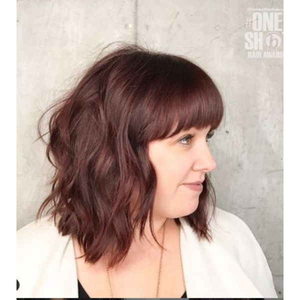 Medium Shaggy Wispy Haircut With Curtain Bangs And Rich Brown Reflections