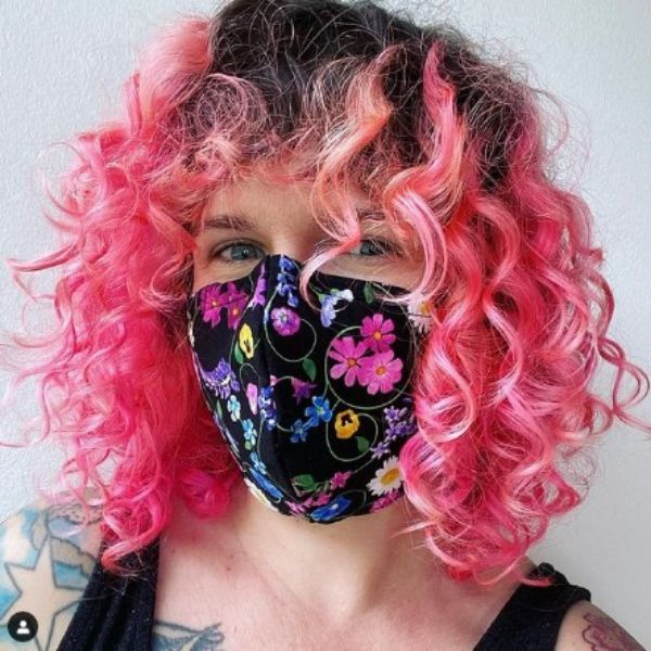 Neon Pink Shoulder Length Curly Hairstyle