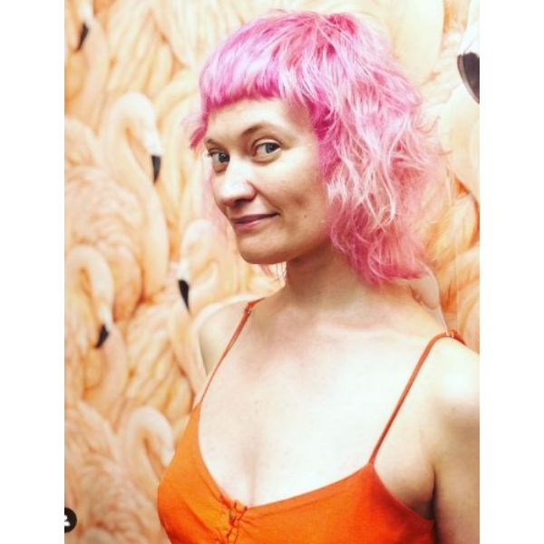 Shaggy Pink Medium Wispy Cut With Straight Bangs
