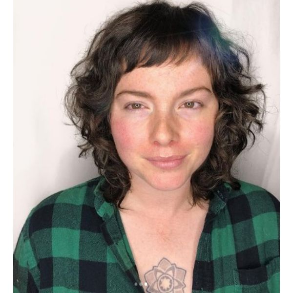 Shoulder Length Carved Curly Shag Haircut With Baby Bangs